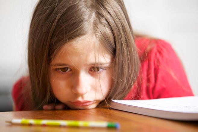 De ce se tem copiii să le spună notele mai puțin bune părinților